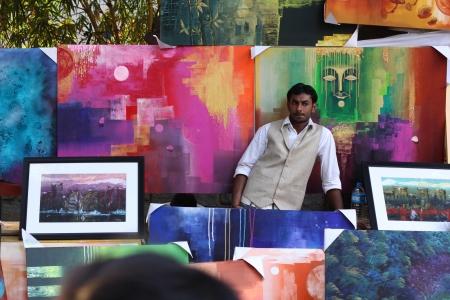 sante: Artist next to his work at Chitra sante - An art fare happenes every year at Chithrakala parishath, Bangalore, Karnataka Editorial