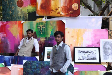 sante: Artists standing next to their work at Chitra sante - An art fare happenes every year at Chithrakala parishath, Bangalore, Karnataka