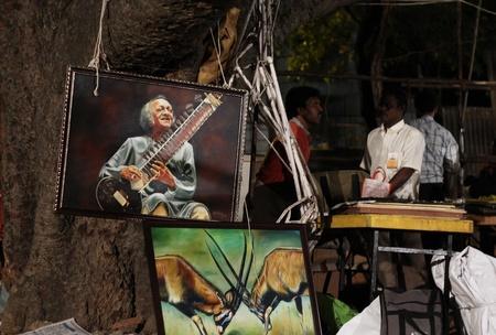 sante: Painted image of Pandit ravishankar seen at chitra santhe Editorial