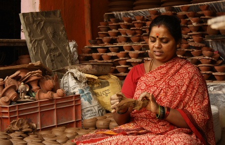 Indian Woman making pottery