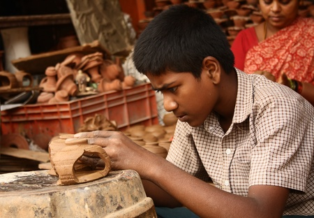 Child labor making pottery in India