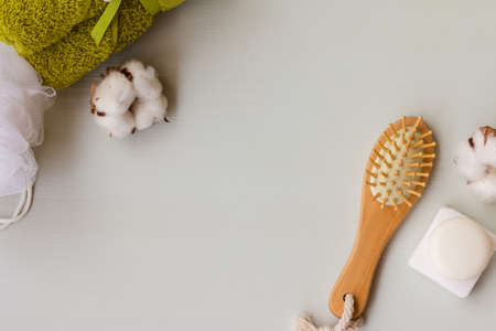 Spa ingridients on a white wooden background. Bath solt, comb, natural soap and towel with a copy space. Stock Photo