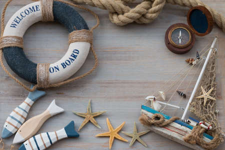 Copy space with a lifebuoy, fish, starfish and boat. Vacation on the sea. Stock Photo