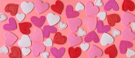 Valentines day decoration. Many hearts on a pink background. Stock Photo