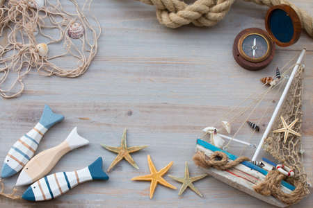Copy space of compass, fish and boat. Marine life. Vacation on the sea.