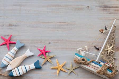 Marine life with seashells, starfish and boat with copy space. Archivio Fotografico