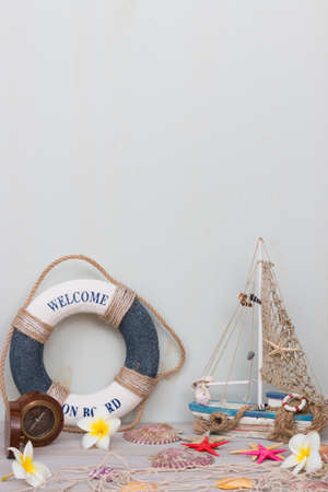 Set of boat, fishing net, starfish and seashells stand on a light gray background. Summer time.