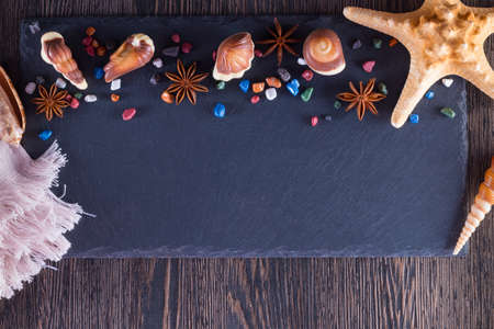 Traditional Belgian shell shape on black background. Candy in form of seafood.