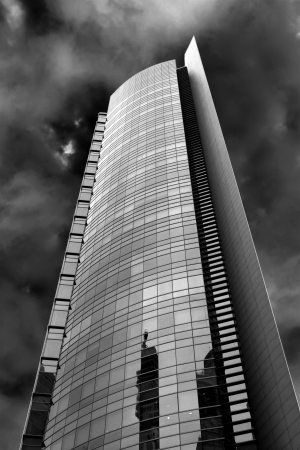 High-rise apartment building in black and white detail in the sky  photo