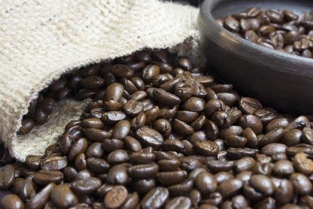 Detail of coffee beans, small clay pot and jute bag photo