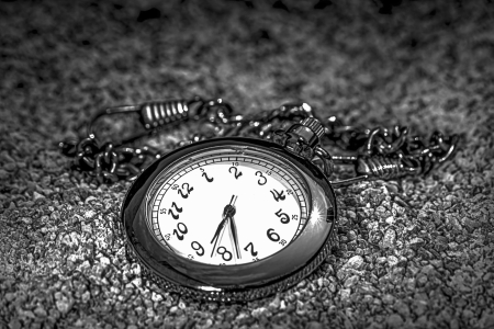 Chain Watch and sand in black and white photo