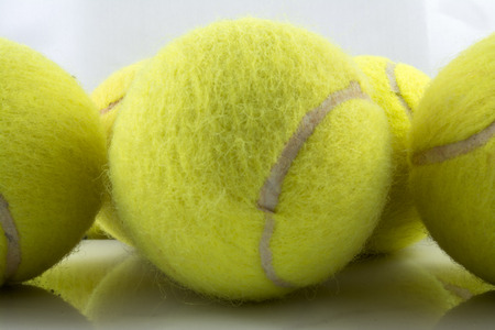 approaching: Approaching tennis balls set  You can see the texture of the fibers and fluoresce