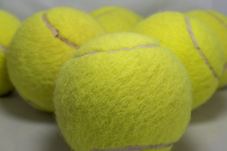 Approaching tennis balls set  You can see the texture of the fibers and fluoresce, photo