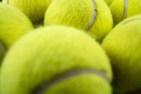 Approaching tennis balls set. You can see the texture of the fibers and fluoresce photo