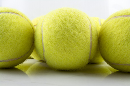tenis: Approaching tennis balls set. You can see the texture of the fibers and fluoresce Stock Photo