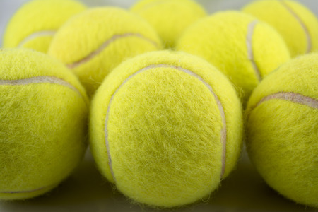 tenis: Approaching tennis balls set  You can see the texture of the fibers and fluoresce