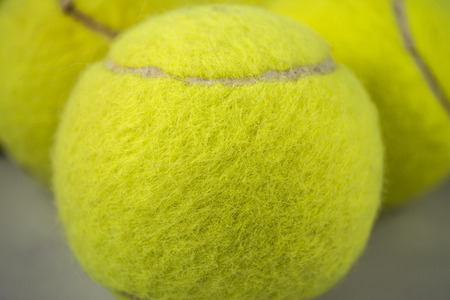 approaching: Approaching tennis balls set  You can see the texture of the fibers and fluoresce,