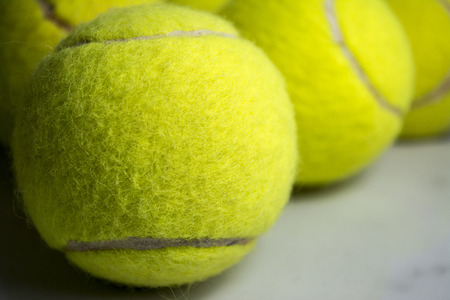 Approaching tennis balls set  You can see the texture of the fibers and fluoresce,