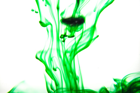 colores: Vegetable ink poured into water with white background.