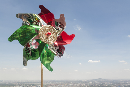 pinwheels: Mexican Rehilete memorial to September 15. Background can appreciate valley of Mexico and the blue sky with clouds Stock Photo