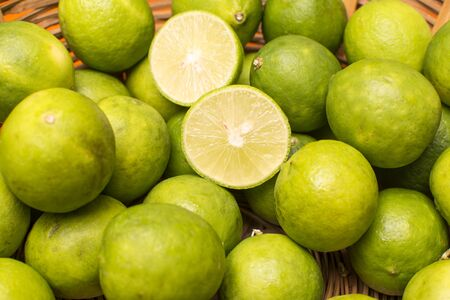 citric acid: Group of lemons in a basket. you can see precise details of the fruit and the basket that contains them