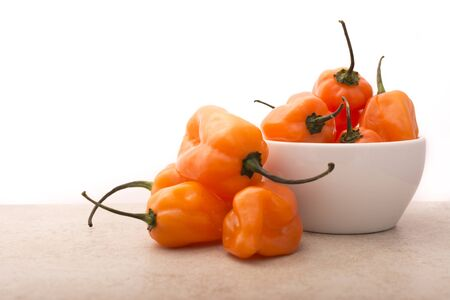 raw food: Approach and details a set of chiles habaneros. Typical of m�rida, yucat�n. is a pepper very spicy and powerful taste. Stock Photo
