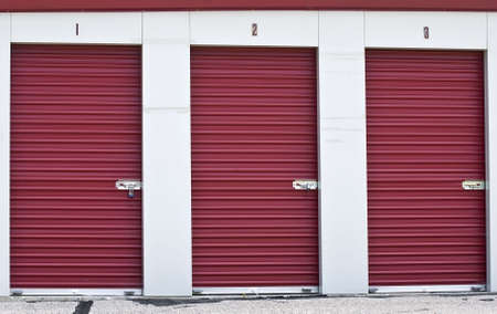 Burgundy colored doors on three locked storage areas