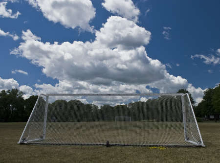 soccer goals in a field on a sunny summer day photo
