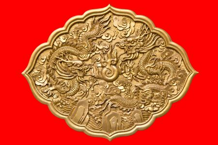 Chinese golden twin dragons on red background  photo