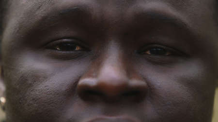 Black lives matter. Close up shot of african man with sad red eyes with tears. High quality photo