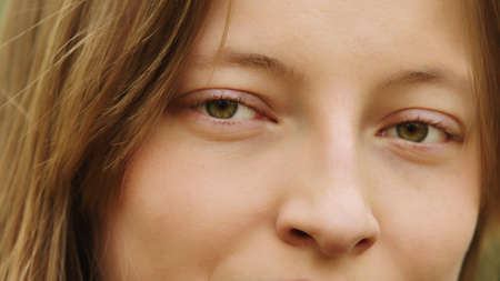 Close up of young caucasian woman s face, Beautiful green azzure eyes. Natural Beauty with Freckles. High quality photo