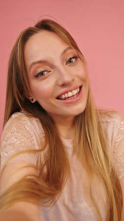 Portrait of beautiful smiling caucasian woman isolated on pink background. High quality photo
