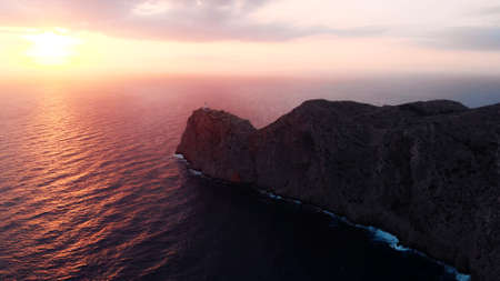 Lantern Cap de Formentor, pink colored sunrise over Lighthouse At Cape Formentor In Coast Of North Mallorca, Spain. . High quality photo