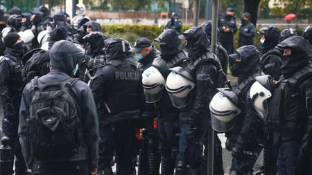 Warsaw, Poland 13.10.2020 - Protest of the Farmers Policemen with facemasks blocking the street. High quality photo Editorial
