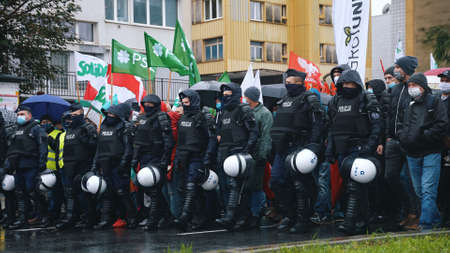 Warsaw, Poland 13.10.2020 - Protest of the Farmers People marching being surrounded by policemen. High quality photo