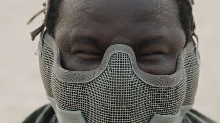Close up, angry african american black man with mask over his face ready for fight. High quality photo