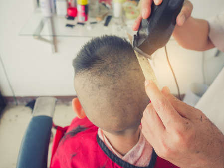 Little Boy Getting Haircut By Barber Stock Photo Picture And