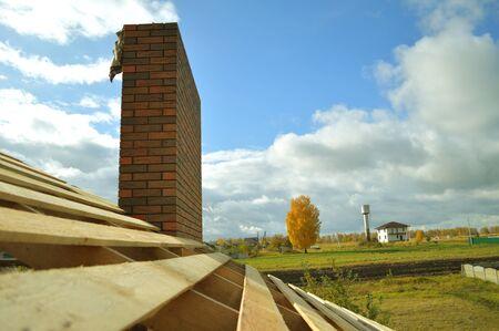 Bitumen tile roof. Roof Docke - Roofing. Stock Photo
