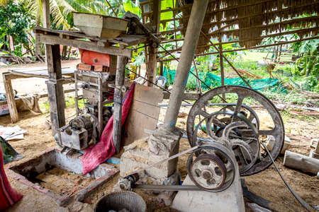 alleppey: Husk machine next to a farm house in Camboida by Siem Reap. AFter they dry the rice this machine is used to take off the husk.