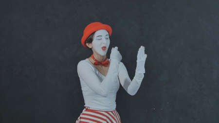 Mime girl going on a date on black background Stock Photo