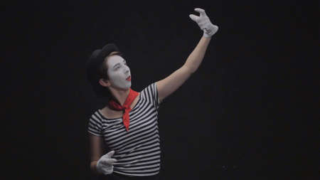 Mime girl photographed on black background Stock Photo