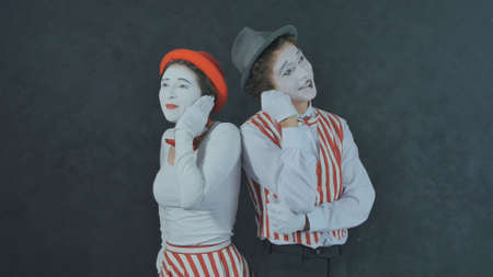 Young Mimes talking on the phone