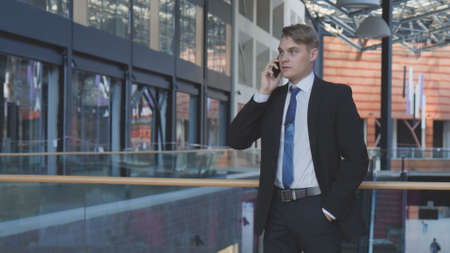 Businessman Talking at Phone