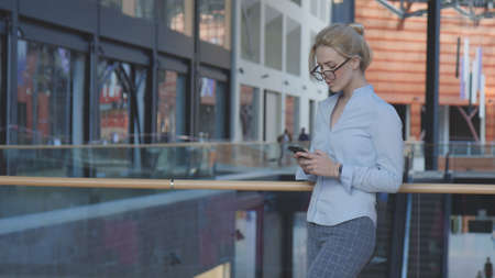 Business Woman Typing Text Message On Phone