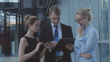 Serious workers discussing business matters Stock Photo