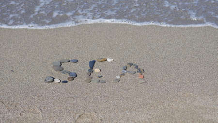 The inscription on the sand. Word of the sea Stock Photo