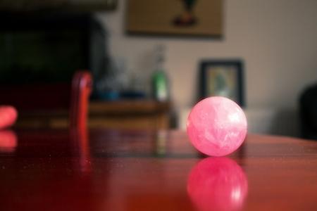 rose quartz: rose quartz crystal on a table Stock Photo