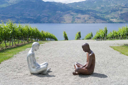 corten: Mission Hill Family Estate,Kelowna, British Columbia, Canada June 21,2017: Flow 1 and 2 are life size sculptures one made of aluminum and one of corten steel The statues are by Steinunn Thórarinsdóttir. Stock Photo