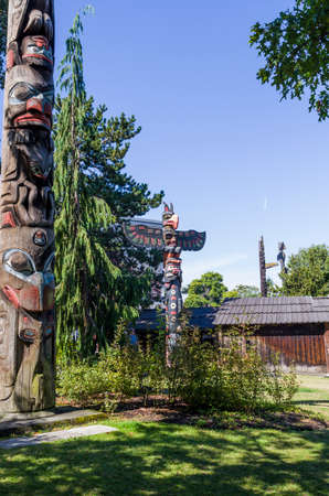 first nations: VICTORIA,BC CANADA SEPTEMBER 1,2013: Totem poles in Thunderbird park carved by indigenous Canadians. The park is part of the Royal BC Museums. Editorial