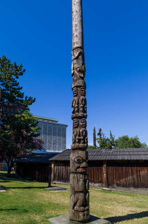 VICTORIA,BC CANADA SEPTEMBER 1,2013: Totem poles in Thunderbird park carved by indigenous Canadians. The park is part of the Royal BC Museums. Editorial